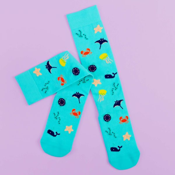 turquoise compression socks with cute little sea creatures like crabs, whales and jellyfish.