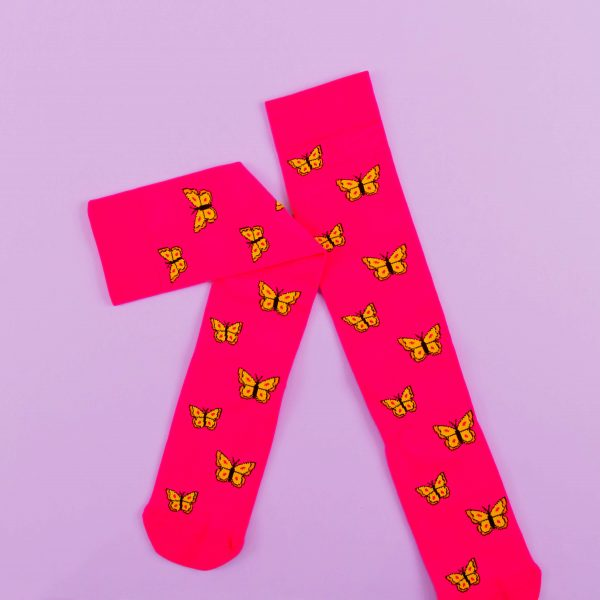 Bright pink compression socks with yellow butterflies.